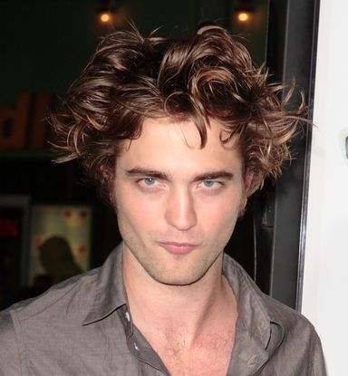 Robert Pattinson with long medium wavy haircut with his wild sexy look.JPG