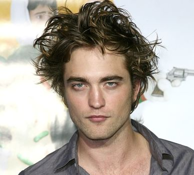 Actor Robert Pattinson image with his long spiky hair looking wild and sleepy at the same time.JPG