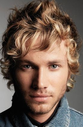 Man long medium curly and wavy haircut in blonde and light brown and side bangs.JPG