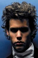 Men light curly and wavy hairstyle in medium hair photo.JPG