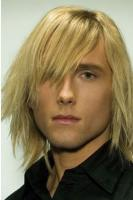 Ice blonde man medium long hairstyle with full of layers and side bang.JPG