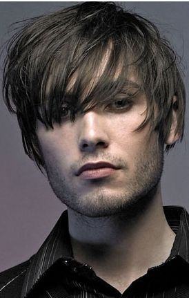 layered men short hairstyle with very long bangs image