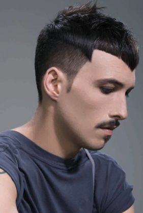men very short haircut with a cool funky look.JPG
