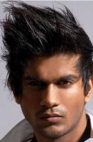 Dark spiky hairstyle with short length int he back.JPG