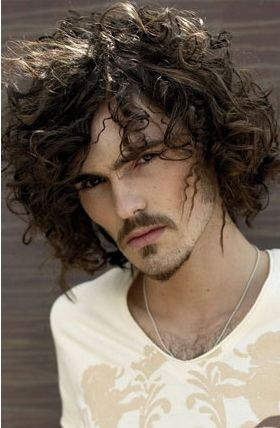 men long wavy hairstyle with curly bangs