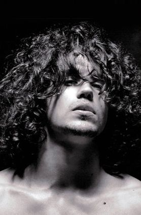 Man curly long hairstyle with very long curly bangs pictures.JPG