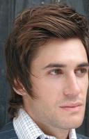 layered medium haircut for men brown hair with swept bang.JPG