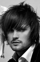 Medium long men stylish hairstyle with very long bangs with full of layers and high lights.JPG