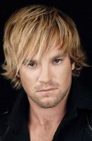 Men blonde modern hairstyle with very long layered bangs.JPG
