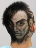 Very unique haircut with human face picture.PNG