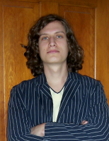 Man long curly hairstyle with very long side bangs.PNG