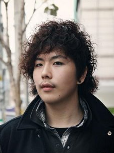 Asian man curly hairstyle with long curly bang and short in the back.PNG