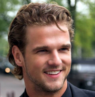 Hot medium man hairstyle with light curls and long bangs pulled to the back.PNG