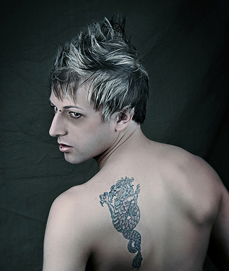 Cool man hairstyle with spiky hair on the top and layers.PNG