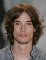 light curly men hairstyle with long side bangs with full of waves.PNG