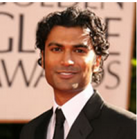 Light curly wavy Indian men hairstyle in long length.PNG