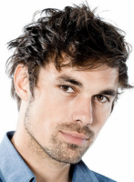 Men layered haircut with medium length and long wavy bangs.PNG